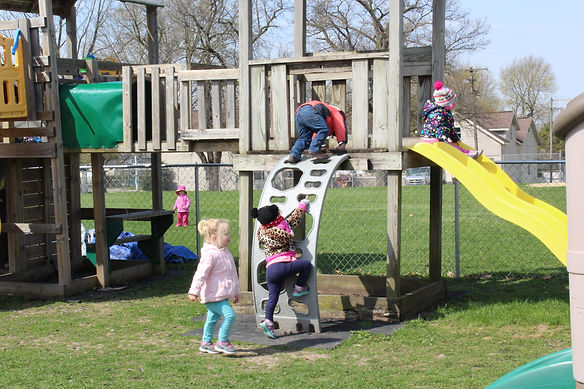 Image of children playing in the outdoor play area