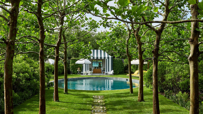 Vogue Metal pool house folley painted to look like a tent.  Photograph by Ricardo Labougle