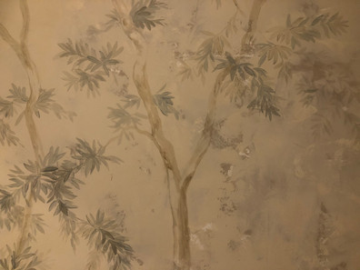 Painted trees on pigmented plaster