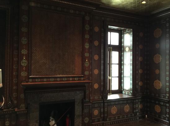 Stenciling on wood paneled walls