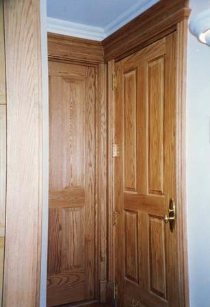 This is a flat steel door, painted to look like a wood paneled door