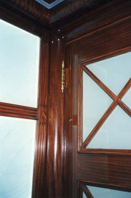 Faux bois on door to match existing woodwork