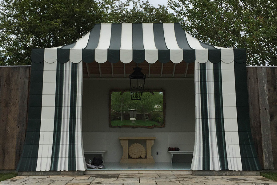 Painted metal tent pool house with trompe l'oeil drapes