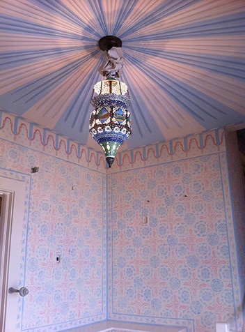 Painted tent ceiling with stenciled walls
