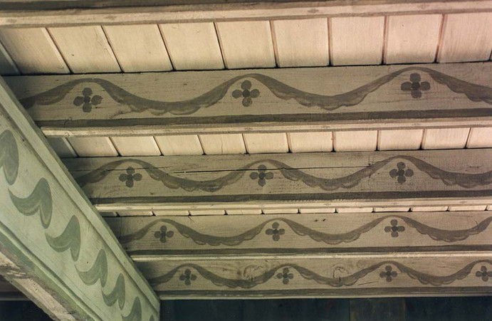 Naively painted beams in Swedish style with antique over-glaze