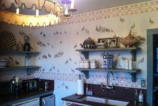 Stenciled walls in bird motif