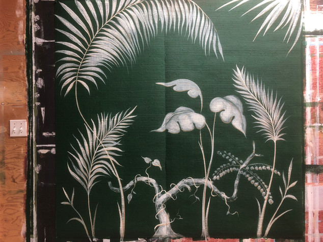 Palm fronds on grass cloth