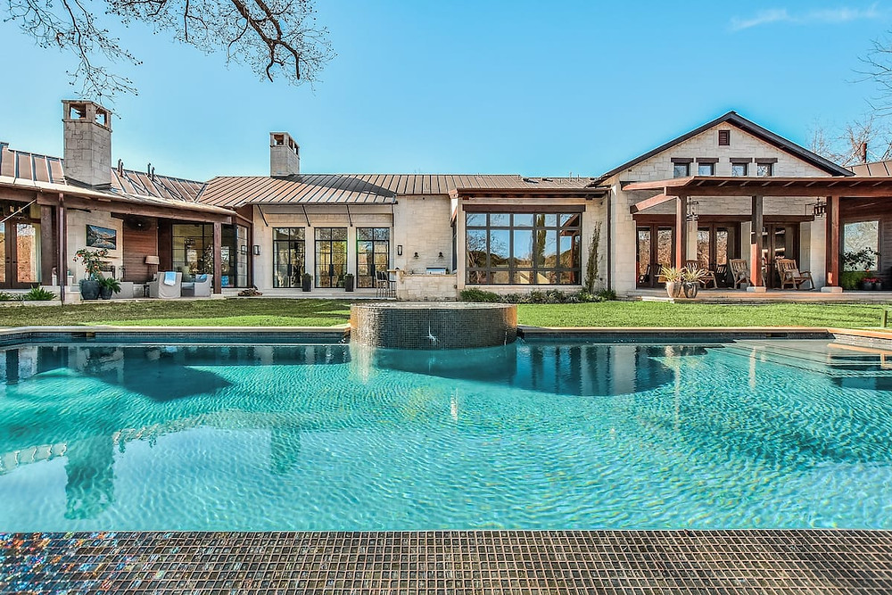 house with pool in front yard