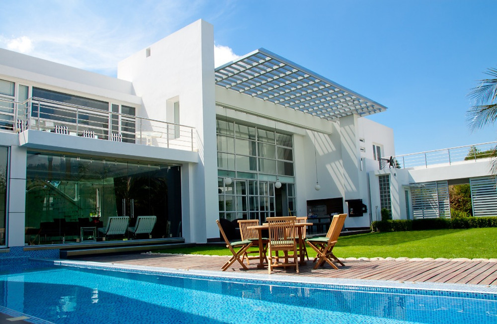Picture of outdoor luxury house with pool and patio