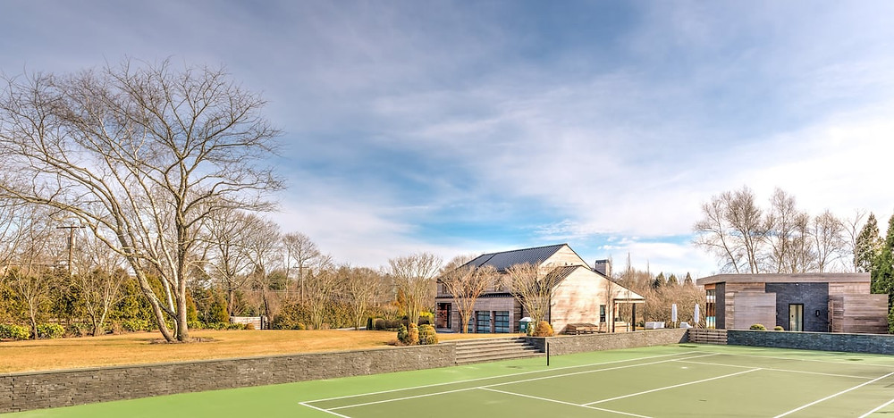 house with tennis court