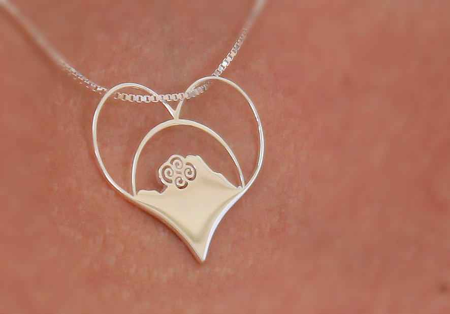 closeup photo of kakona pendant featuring clouds over mount scenery in a heart