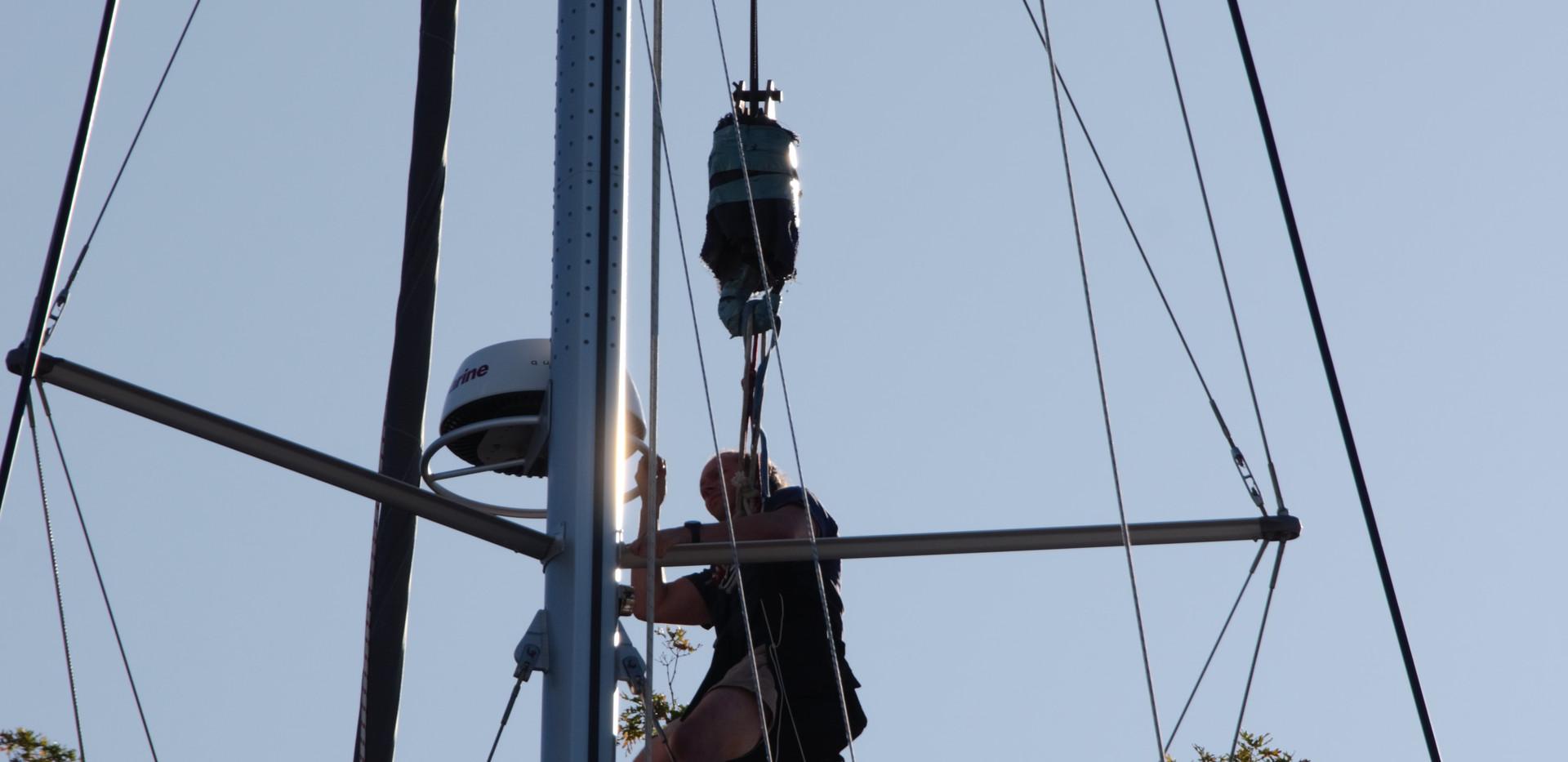 """ABYC Technician, Sean, replacing a radar on 45 Leopard, """"Pasajero del Viento""""."""