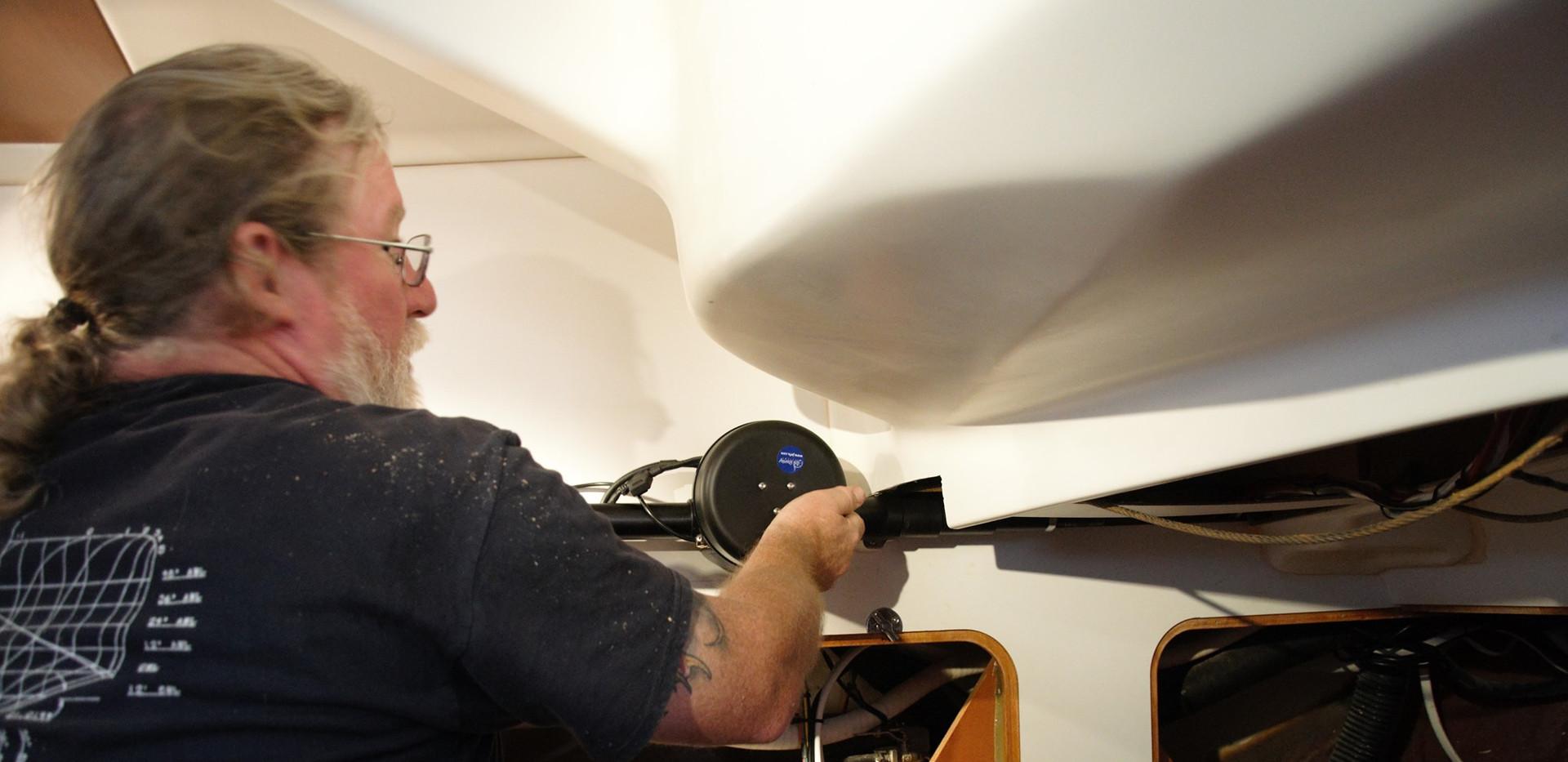 ABYC Master Technician, Eric, installing an autopilot.