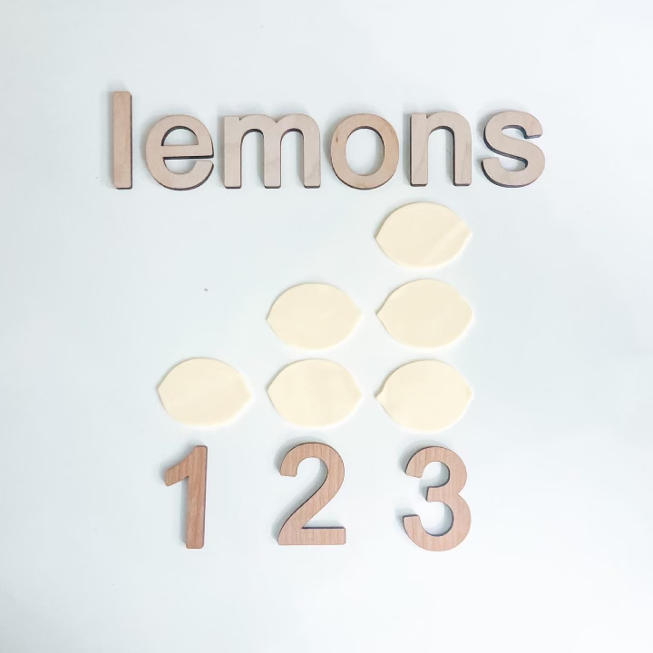 Play dough counting lemons activity with beautiful wooden letters and numbers from Smiling Tree Toys
