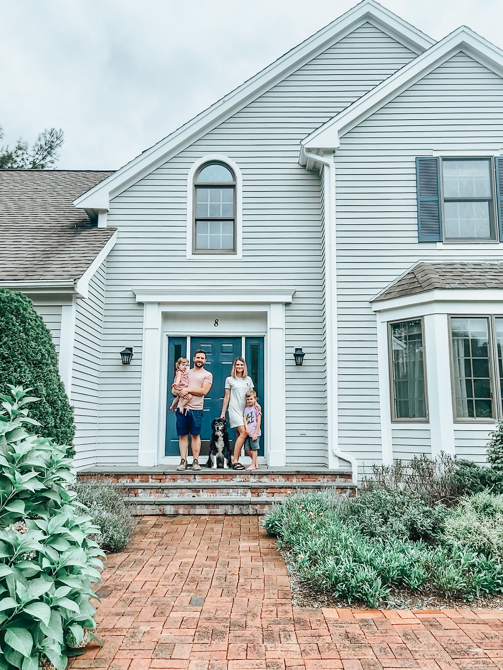 Family portrait in front of new house