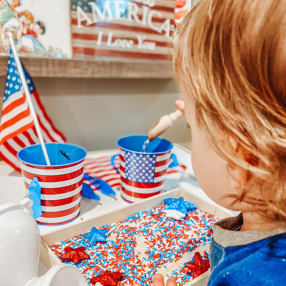 Patriotic Sensory play with red white and blue sprinkles