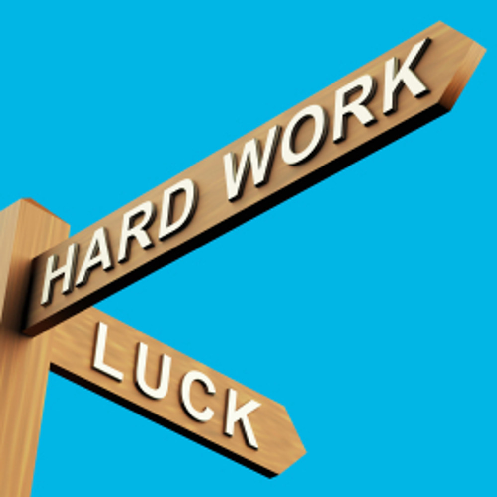Hard Work Or Luck Directions On A Signpost
