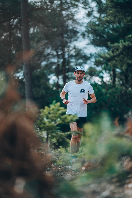 KOTWF athlete Arne Dumez runs through Swinley Forest