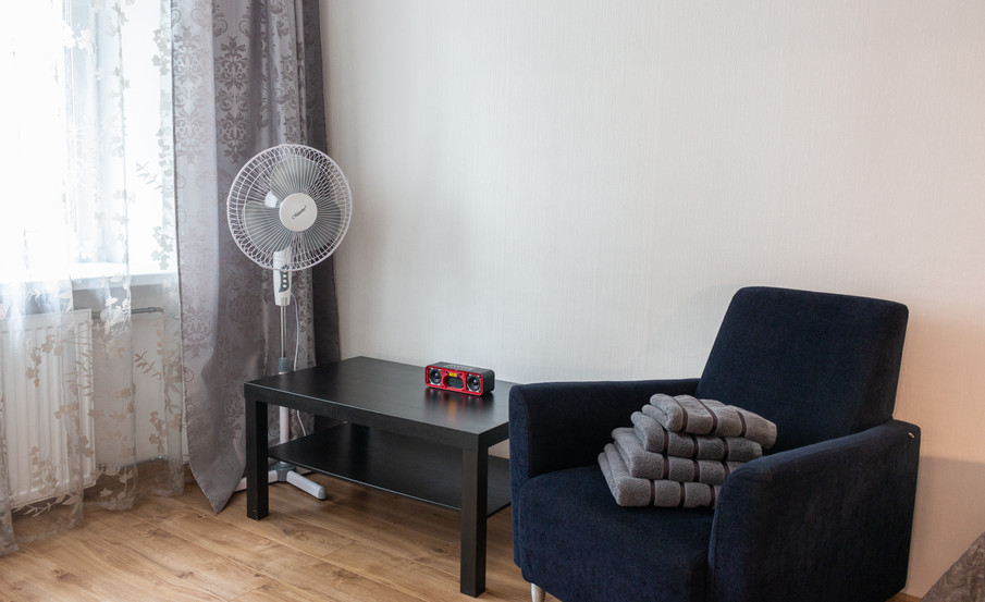 Bedroom table, Armchair and Fan