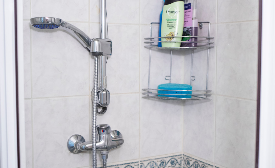 Shower with soap and shampoo
