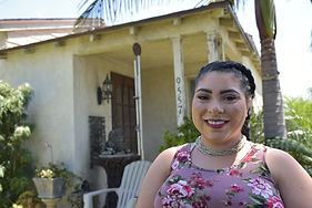 Pico Rivera resident wearing floral top and necklace.
