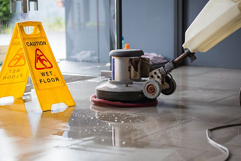 The people cleaning floor with machine..jpg