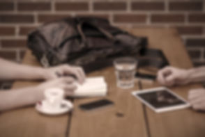 two people meeting with iphone and ipad_edited.jpg