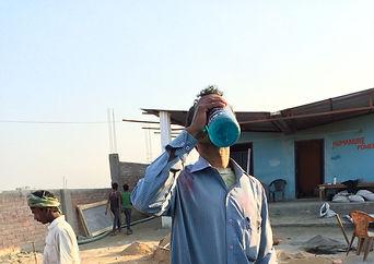 Indian man drinking water