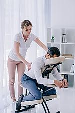 masseuse doing back massage for business
