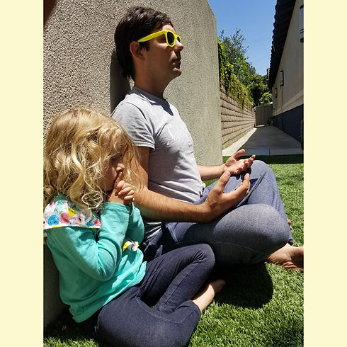 Teacher Jimmy and a Student Meditating at the Arise & Shine's Mindfulness Class