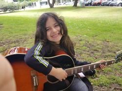 Siren Playing Guitar