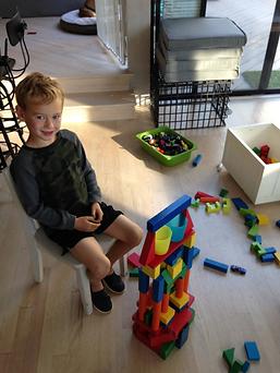 Eli making Building Blocks during Arise & Shine's tutoring class