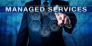 Male business consultant is touching MANAGED SERVICES an a virtual interactive control int