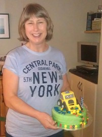Kath with her latest cake - a digger for a little boy.