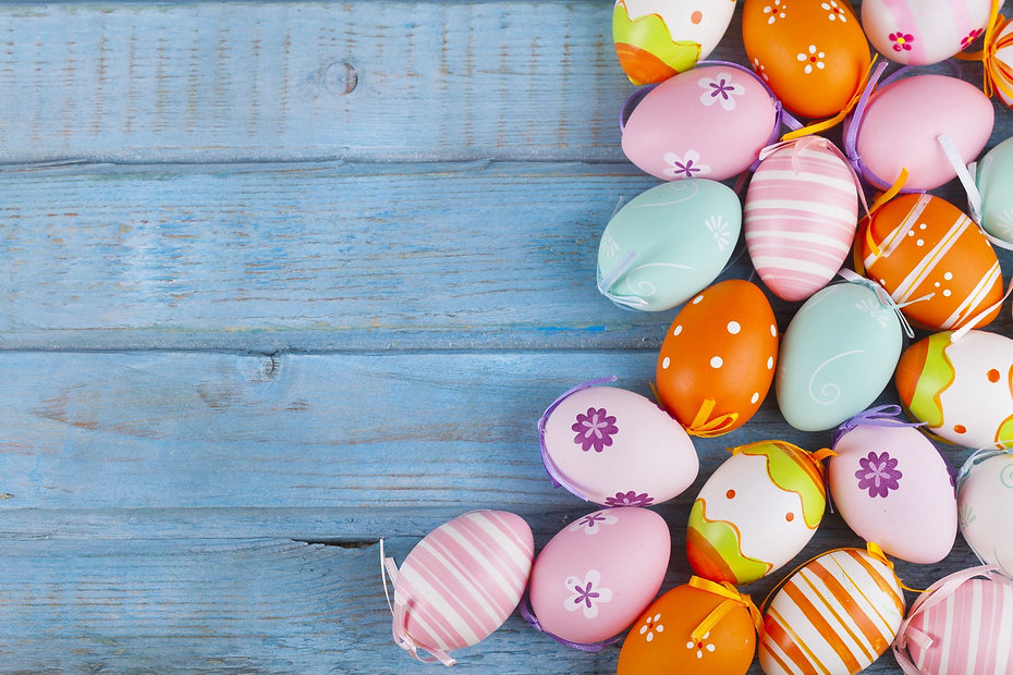 colorful-easter-eggs-on-turquoise-wooden