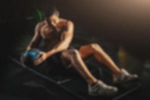 Athletic man doing abdomen exercise on t