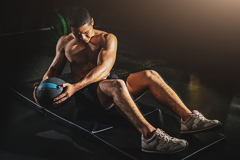 Athletic man doing abdomen exercise on t