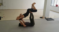 Acroyoga flying butterfly pose
