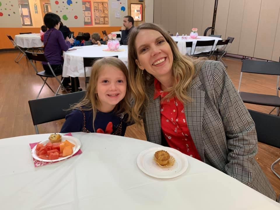 Child and mother having breakfast in the indoor gym for Mother's day