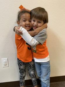 Best friends in the three year old program hugging each other
