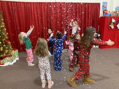 Kids playing with snow at the preschool's winter party