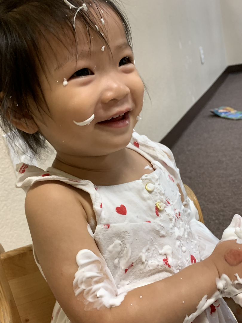 One year old playing with shaving cream in the classroom