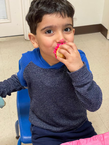 Pre-K student enjoying a cupcake in the daycare classroom