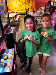 Having fun at the arcade during the summer camp field trip in Frisco