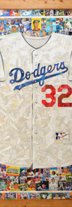 """Sandy Koufax Jersey  Full size Dodgers jersey replica made entirely with original Dodgers baseball cards, including cards from the 1950's through current players.  Made for a Sandy Koufax fan (the white of the jersey is the backs of cards, not all Dodgers cards). Full size replica, 42""""x48"""". Included are many Dodgers stars, including Sandy Koufax"""