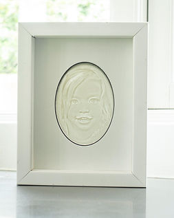 lithophane of young girl made by ceramafacturers