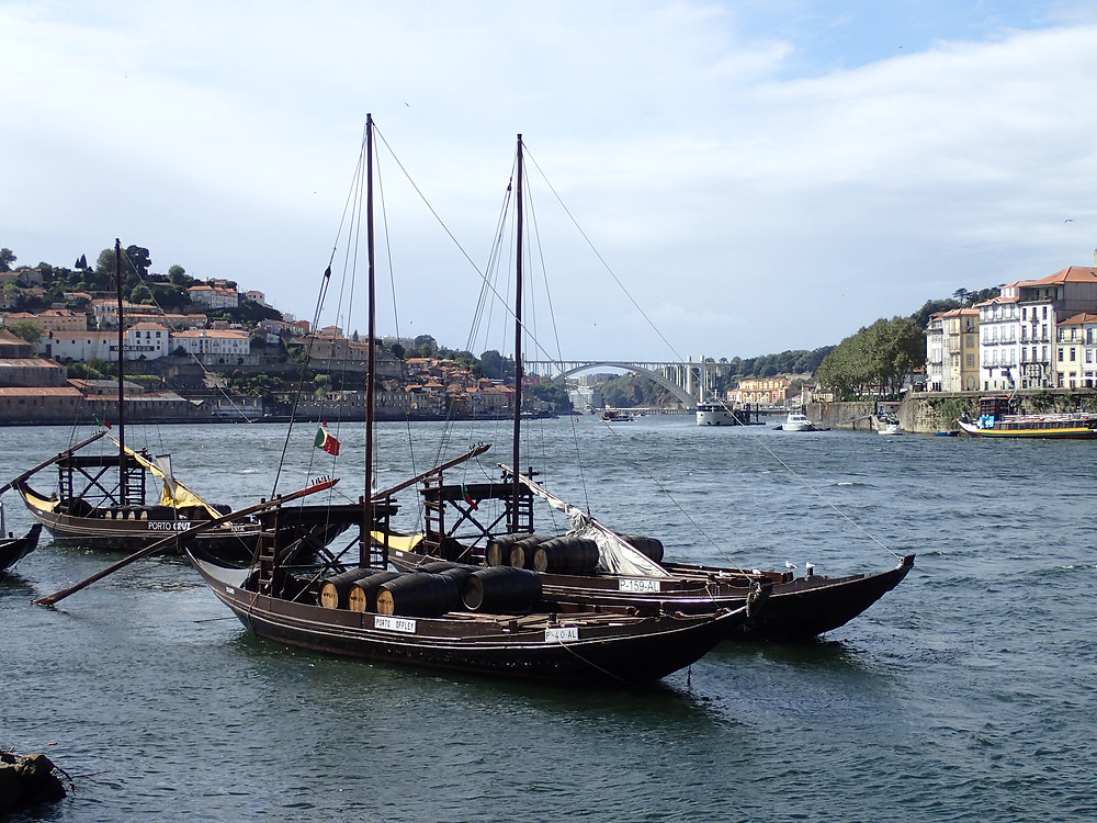 Oporto with the traditional river craft used to bring the barrels of port down river to the port houses.