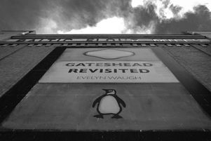 Black and white urban and landscape photography. A huge facsimile of a Penguin Books cover drapes the wall of the Baltic Flour Mill in Gateshead, UK