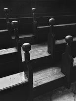 Black and white urban and landscape photography. Worn wooden steps and benches at the Bodleian Library in Oxford, UK