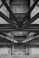 Black and white urban and landscape photography. Steel girders frame a service door beneath the Tyne Bridge in Newcastle-upon-Tyne, UK